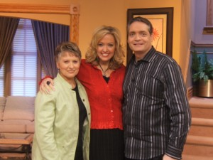 """Grace with Ann and Ron Mainse on the set of """"100 Huntley Street"""""""