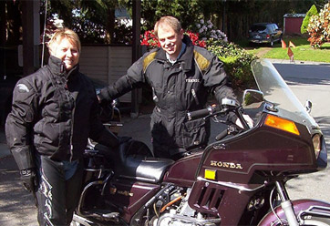 Grace with her husband, Gene, and their Honda Goldwing